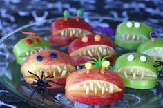 Put a little bite on the plate with these scary Apple Monsters. Quarter the apples, take a wedge out, dunk them in lemon juice water to prevent browning. Add some slivered almonds for teeth. #diettogo #healthyhalloween