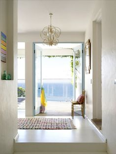 White entryway with gold light fixture
