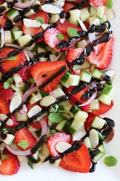 Strawberry Cucumber Salad – drizzled with balsamic glaze, an easy, light salad.  Whole 30