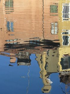 reflection of two houses in a Venetian canal