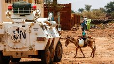 A Sudanese boy rides a donkey past a UN-African Union mission in Darfur (UNAMID) armoured vehicle in the war-torn town of Golo in the thickly forested mountainous area of Jebel Marra in central Darfur. New Africa, Africa News, South Africa, Global Stock Market, African Union, Voice Of America, Global Stocks, Central And Eastern Europe, Picture Editor