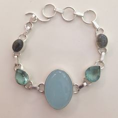 % 925 silver bezel chalcedony topaz bracelet Price ⤵️  drop- Adjusts Approx. 6.5-8 inches, % 925 Sterling silver bracelet with toggle clasp, adorned with bezel gem stones of % Sky  Blue Chalcedony, oval, smooth shape centerpiece . % Swiss Topaz faceted, pear shaped gem stones, flanking Chacedony & % labradorite, oval, metallic gem stones flanking Topaz gems. . Hand made/crafted. High quality, NWOT very lovely bracelet  Hand made Jewelry Bracelets