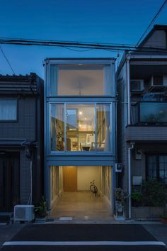 Designed by the Japanese architecture studio YYAA, this small narrow house can be found in a dense residential street in Osaka. The house was created for Narrow House Designs, Small House Design, Japanese Architecture, Architecture Design, Compact House, Box Houses, House Built, Bungalows, House Plans