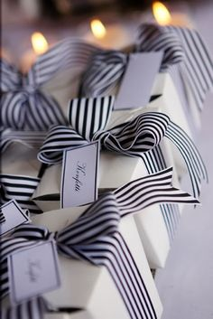Black and white packages with pretty striped ribbon. We love presents!