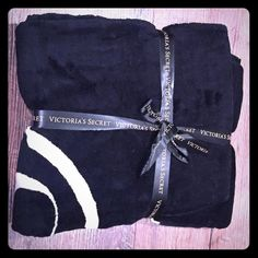 Victoria's Secret Blanket Brand new comes in its original plastic and ribbon. Super soft black and pink Victoria's Secret Other