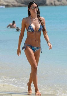 Bravissimo! Elisabetta Gregoraci, 36, cut a far more youthful figure than her years as she flaunted her rippling abs in a skimpy bikini while on the beach in Mykonos on Sunday