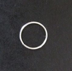 This is for a SINGLE hoop ring perfect for your upper ear, nose, eyebrow, or wherever else you have pierced! This is not a cuff, it is an actual piercing ring!  It is hand made with 21 gauge Argentium Silver, which is 92.5% Sterling Silver and 7.5% germanium; the germanium drastically slows down the tarnishing effect that is common with Sterling Silver, as such no special care is needed...