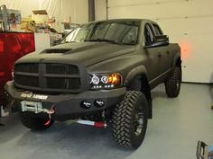 Great looking Dodge Ram 1500 with matte black paint job.
