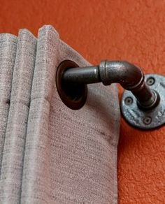 Metal pipe curtain rod idea to sue for grommet curtains in your industrial chic farmhouse loft.