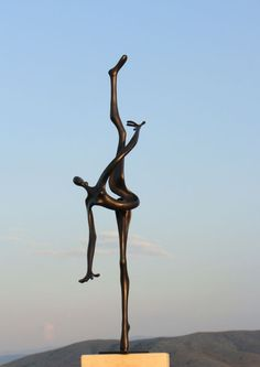 #Bronze #sculpture by #sculptor Plamen Dimitrov titled: 'Graceful (Tall Elegant Slim abstract Gymnast statue)'. #PlamenDimitrov