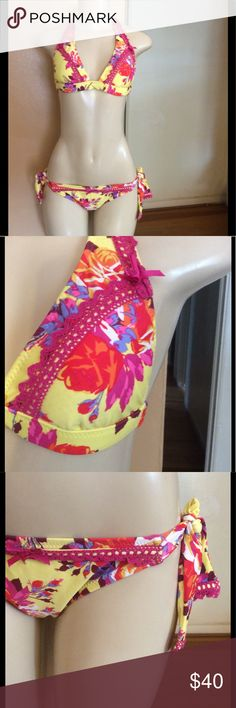 Betsey Johnson bikini Cute yellow bikini with bright flower print. Bottom ties at sides, lace detail on both top and bottom. Top has built in padding. Inside of both pieces has red polka dots .  In great condition. Size small.  Bundle and save. Please use offer to negotiate. No holds and no trades. Betsey Johnson Swim Bikinis