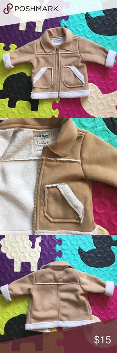 Old Navy Suede Look Infant Coat Old Navy Coat. Size 3-6 months. Suede look. This coat is so warm, the inside is ultra soft. Gently used. No stains or flaws. The 'this belongs' tag hasn't even been filled out! My daughter JUST outgrew it. This could easily be used for a baby boy, as well. Old Navy Jackets & Coats