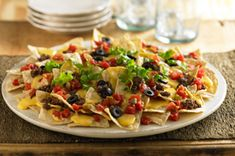 Ultimate Nachos -- I've been thinking about making nachos lately, so this looks like an easy recipe to try! #kraftrecipes