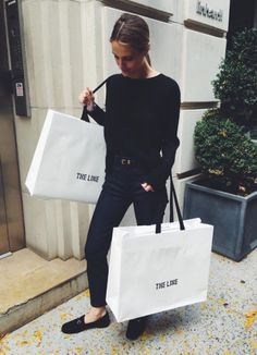 Vanessa Traina wearing all black -- sweater, cropped pants, gucci loafers