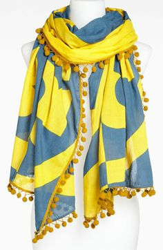 Tory Burch Reva Print Pom Pom Scarf | The evil eye is an emblem of protection and well-being for all those who wear it. If that wasn't enough of a reason to snatch up this versatile style, the colors and print are gorgeous to boot! via @stylelist