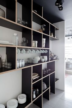 Something like this for the shelves in the office? {plywood and plastic laminate shelves in kitchen in 'We' Hostel in Sao Paolo, Brazil by Felipe Hess and Guilherme Perez} Kitchen Shelves, Kitchen Storage, Kitchen Drawers, Plywood Kitchen, Book Shelves, Kitchen Cabinets, Kitchen Organization, Kitchen Interior, New Kitchen