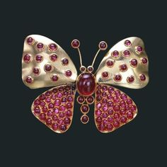 Suzanne Belperron ruby and gold butterfly brooch.