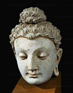 BUDDHISM SCULPTURE 3RD-6TH     Head of Buddha from the Monastery of Tapa-Kalan, Hadda,Afghanistan. 3rd-4th CE Stucco,19 x 11,5 x 12 cm TK 141     Musee Guimet, Paris, France