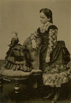 Little girl with her french fashion doll Circa 1870's