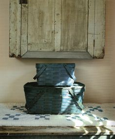 Prim Blue Painted Picnic Baskets...blue & white quilt...old creamy cupboard.