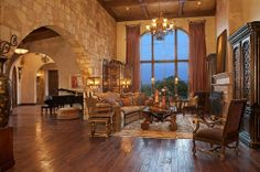 Old world warmth & charm ...like the ceiling the floor the stone wall and the long drapery