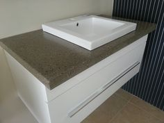 Polished concrete vanity top by Mitchell Bink Concrete Design. www.mbconcretedesign.com.au