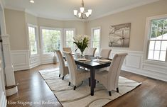 Contemporary Dining Room with Crown molding, Chair rail, Wainscotting, Chandelier, Hardwood floors