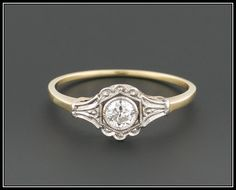 A gorgeous diamond engagement ring from the Edwardian era (circa 1900-1910)!  This antique ring features a 15 point (0.15 carat) transitional