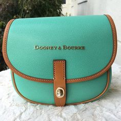 FINAL SALE⚡️Dooney and Bourke Crossbody FIRM PRICE ✨ NWT Dooney & Bourke Claremont Crossbody. This gorgeous bag is perfect for someone on the go. It's very stylish and the inside colors really stand out. Color: Sea Foam. Leather, gold tone hardware, turn lock closure, and adjustable shoulder strap. Dust bag is included. 💯 authentic. Measures: 7H x 8L x 3D. 🚫No trades. Dooney & Bourke Bags Crossbody Bags