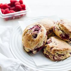 Coconut Raspberry Scones served with fresh, creamy yogurt is a pairing unlike any other, and perfect for your next tea party! Made with coconut cream, these scones are tender and moist, and bursting with raspberries.