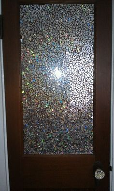 Don't throw those old scratched CD's away.Shatter them with a hammer(use eye protection!) and glue as a mosaic with modge podge onto a closet door.. (or practically anything)