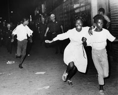Two terrified African American girls flee police officers during social unrest in the Bedford-Stuyvesant neighborhood of Brooklyn. This is the second night of social unrest, which began in Harlem, July 21, 1964. Photo credit: Bettmann / Getty