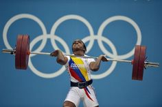 TOPSHOTS  Colombian's Jackelina Heredia Cuesta competes during the weightlifting women's 58kg group A event at The Excel Centre in London on July 30, 2012, during the London 2012 Olympic Games. AFP PHOTO / YURI CORTEZYURI CORTEZ/AFP/GettyImages Photo: Yuri Cortez, AFP/Getty Images / SF