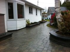 Back patio and walkway with pavers and raised planters