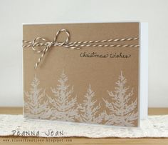 Love this minimalist Christmas card, with simple white trees stamped on kraft paper. Stamp your sentiment and tie it off with some baker's twine. DIY