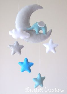 ♥ WELCOME TO LOVEFELT CREATIONS ♥  All my mobiles are made with much love, with a great amount of care and consideration invested in their design and production. DETAILS AND DIMENSIONS: ======================= Each plush element is created with felt, lightly filled with hypo-allergenic polyester stuffing.   The moon measures 8x6.5 and enclosed there is a long string for ceiling h...