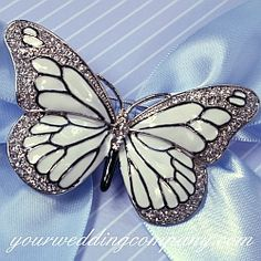 Crystal & Enamel Butterfly Brooch (3 colors); Item:AC154  measures 2-3/4 inches across and 1-1/2 inches high. Available in white, turquoise, and purple.  $16.95