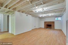 """Nice. Basement ceiling, ductwork, etc... painted white with lighting ---makes basement look clean, bright -- a bit of an industrial loft feeling.  """"1308 TUCKERMAN St NORTHWEST WASHINGTON, DC 20011"""" $799K"""
