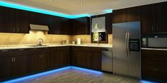 Kitchen cabinets with blue LED strip lighting