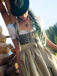 Woman wearing a beautiful traditional Dirndl by the Austrian brand Gössl #austria #dirndl #costume #tradition #goessl #hat #nature