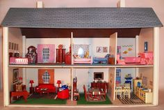 A whole (Rich) house of Reliable dollhouse furniture. Kitchen and bath are made from Ideal molds. Dining set and living room are splendid expressions of 1950s colonial revival.