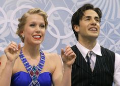Kaitlyn Weaver and Andrew Poje of Canada wait in the results area after competing in the ice dance short dance figure skating competition at...
