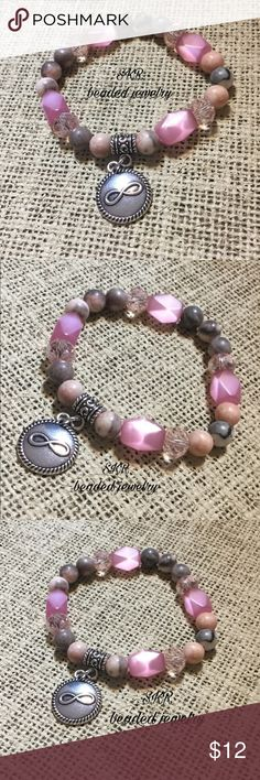 Pink jasper bead bracelet with infinity charm Gorgeous pink jasper beads with various pink glass beads...elastic fit for easy on and off...comes with infinity charm.  Great gift for anytime or occasion. handmade Jewelry Bracelets