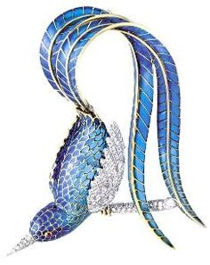 Mellerio brooch 1942. This bird's blue plumage is plique-a-jour enamel, which is backless and as transparent as a stained glass window.