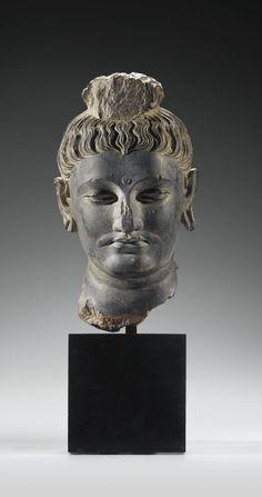 A WELL-CARVED GREY SCHIST HEAD OF BUDDHA, GANDHARA, 2ND/3RD CENTURY AD