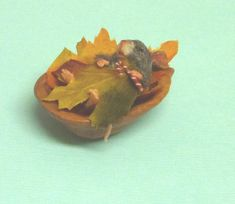 Mouse in his Walnut Shell Bed by Mini Menagerie, via Flickr