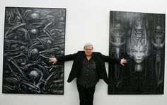 HR Giger  poses with two of his works at his exhibition at the art museum in Chur, Switzerland.