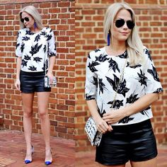 Pair a floral top and leather shorts for this look.