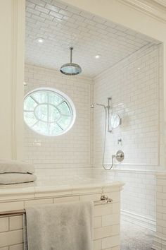 Like the floor to ceiling tile - half wall and walk-in shower! Even without the decorative trim tiles