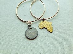 Beautiful brass banglesadorned by silver   gold metallic charms.The bracelets open